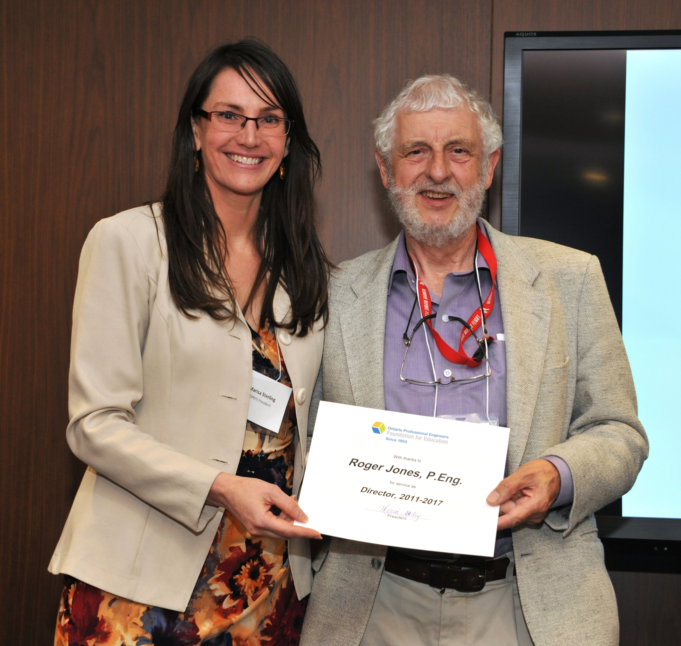 12 retiring director Roger Jones receives certificate of appreciation from Marisa Sterling